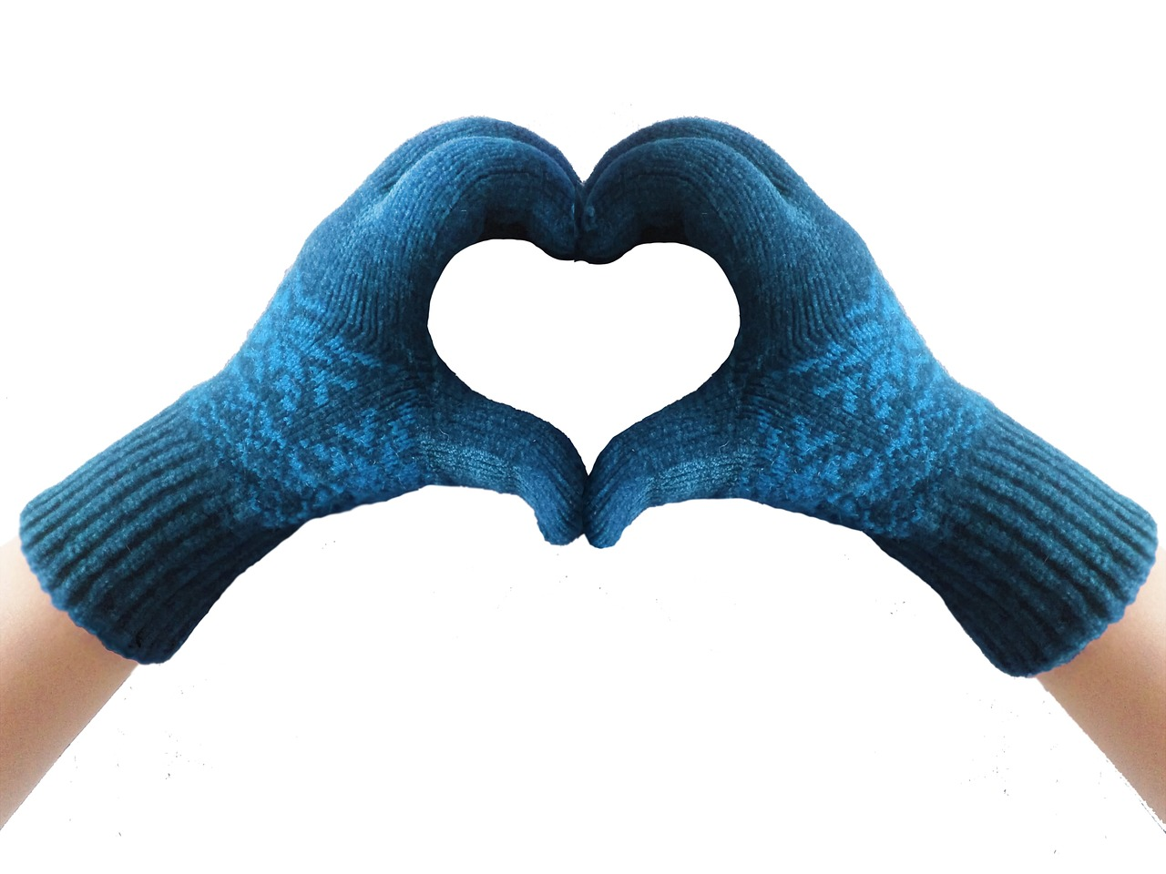 Two hands in blue winter gloves making a heart shape